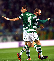 LISBON, April 13, 2018  Sebastian Coates (L) and Stefan Ristovski of Sporting celebrate during the Europa League quarterfinal second leg soccer match between Sporting CP and Club Atletico de Madrid at the Jose Alvalade stadium in Lisbon, Portugal, on April 12, 2018. Sporting won 1-0 but was eliminated by a 1-2 on aggregate. (Credit Image: © Zhang Liyun/Xinhua via ZUMA Wire)