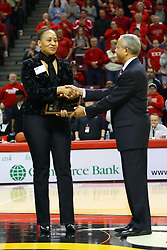 07 February 2009: ISU President Al Bowman presents Charlotte Lewis's sister a plaque in her honor. Charlotte Lewis was the first All-American in Illinois State University's women's basketball program and a silver medalist in the Olympics Illinois State increased their 1st place lead by beating 2nd place Indiana State by a score of 69-48. The Illinois State University Redbirds hosted the Indiana State University Sycamores on Doug Collins Court inside Redbird Arena on the campus of Illinois State University in Normal Illinois