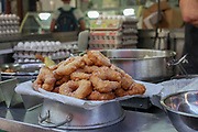 Freshly fried Sfenj a Maghrebi doughnut: a light, spongy ring of dough fried in oil. Sfenj is eaten plain, sprinkled with sugar, or soaked in honey.