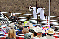 Coy Huffman speaks to folks gathered for a Cowboy Church Service on Sunday, the last day of the 2013 California Rodeo Salinas.