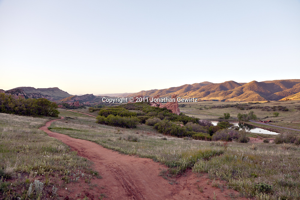 A bike and walking trail in the South Valley Park Ken-Caryl Ranch Open Space in Colorado at dawn. <br /> <br /> WATERMARKS WILL NOT APPEAR ON PRINTS OR LICENSED IMAGES.<br /> <br /> Licensing: https://tandemstock.com/assets/78437088