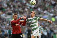 06/08/14 UEFA CHAMPIONS LEAGUE 3RD QUALIFYING RND 2ND LEG<br /> CELTIC v LEGIA WARSAW<br /> BT MURRAYFIELD STADIUM - EDINBURGH<br /> Jakub Rzezniczak (left) battles with Celtic's Stefan Johansen
