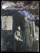 damaged portrait of sisters posing together France 1930s