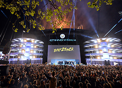 Manchester City's players and staff celebrate on stage in front of the fans in the crowd during the celebrations at the Etihad Stadium after securing the Premier League title earlier in the day with their win at Brighton and Hove Albion.