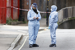 © Licensed to London News Pictures. 24/05/2021. London, UK. Forensics officers are seen at Consort Road in Peckham south London after Black Lives activist Sasha Johnson was shot. Ms Johnson remains in a critical condition in hospital after the shooting which happened at 3am on Sunday morning. Photo credit: Peter Macdiarmid/LNP
