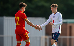NEWPORT, WALES - Friday, September 3, 2021: England's Luke Chambers (R) shakes hands with Wales' Morgan Wigley after an International Friendly Challenge match between Wales Under-18's and England Under-18's at Spytty Park. (Pic by David Rawcliffe/Propaganda)