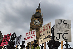 Parliament Square, Westminster, London, June 27th 2016. Thousands of Labour's Momentum members and their supporters gather in Parliament Square in a display of support for embattled Labour Leader Jeremy Corbyn as he suffers numerous calls for his resignation by party members, saying he has does not have the authority to lead the divided party, following his less than emphatic support for Remain in the EU referendum. PICTURED: Placards festoon the railings surrounding Parliament following the rally.