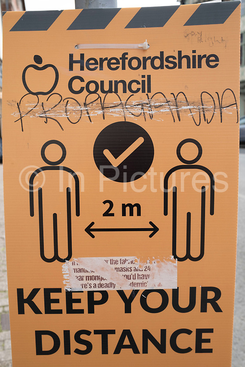 Anti-vaxxer defaced social distancing sign during the coronavirus or Covid-19 pandemic reads propaganda on 9th June 2021 in Hereford, United Kingdom. After months of lockdown, and easing beginning, social distancing measure and signage are still in place, much to the consternation of local rural anti-vaccine supporters. Among vaccine hesitancy are groups known as anti-vaxxers or anti vax, who are generally against vaccination.