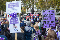 London, UK. 5 November, 2019. Campaigners from WASPI (Women Against State Pension Inequality), many dressed as suffragettes, protest in Parliament Square to call for fair transitional pension arrangements for women born in the 1950s affected by the changes to the State Pension Age (SPA), including a 'bridging' pension to provide an income from age 60 until State Pension Age and recompense for losses incurred by women who have already reached their SPA.