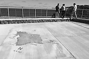 A map of the island of Oahu is etched in the concrete at the parking area for the Halona Blow Hole in Hawaii.