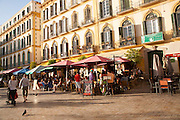 People enjoying a sunny spring afternoon in bars on the Plaza de la Merced, Malaga Spain