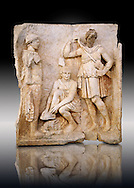 Photo of Roman relief sculpture, Aphrodisias, Turkey, Images of Roman art bas reliefs.  Meleager sits on a rock tying his sandal. Below him lies a fierce hunting dog with a wide collar. On one side a god or another hero wearing a rounded hat  crowning Meleager ( arm missing). On the other side stands the huntress Atalante, Meleager's lover: she wears a short dress and quiver, .<br /> <br /> If you prefer to buy from our ALAMY STOCK LIBRARY page at https://www.alamy.com/portfolio/paul-williams-funkystock/greco-roman-sculptures.html . Type -    Aphrodisias     - into LOWER SEARCH WITHIN GALLERY box - Refine search by adding a subject, place, background colour, museum etc.<br /> <br /> Visit our ROMAN WORLD PHOTO COLLECTIONS for more photos to download or buy as wall art prints https://funkystock.photoshelter.com/gallery-collection/The-Romans-Art-Artefacts-Antiquities-Historic-Sites-Pictures-Images/C0000r2uLJJo9_s0