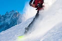 Off-piste Snowboarding in Powder Snow against Blue Sky