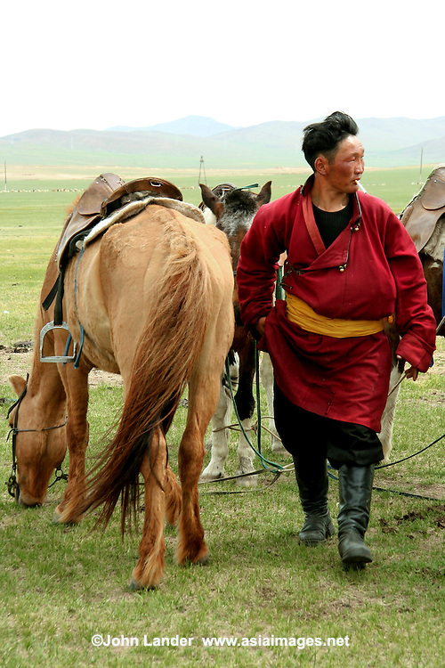 Nomads move around the steppes of Mongolia depending on the season, water availability and whether or not they like their neighbors, this rugged individual included. Nomadic people move from one place to another, rather than settling permanently in one location.  Nomads in Mongolia usually follow seasonal  game & wild plants, moving along with them so as to avoid depleting pastures beyond the ability to recover.