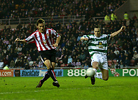 Photo: Andrew Unwin.<br />Sunderland v Northwich Victoria. The FA Cup. 08/01/2006.<br />Sunderland's Dean Whitehead (L) fires home his team's second goal.