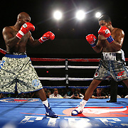 Taronze Washington (L) and Yamaguchi Falcao square up against each other during a Fire Fist Boxing Promotions boxing match at the A La Carte Pavilion on Saturday, August 12 , 2017 in Tampa, Florida.  (Alex Menendez via AP)