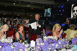 Auctioneer CHARLIE ROSS at The Butterfly Ball in aid of Caudwell Children held at the Grosvenor House, Park Lane, London on 25th June 2015