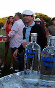 **EXCLUSIVE** .Matthew Settle and girlfriend..Gossip Girl actor, Matthew Settle was glued to the hips with his girlfriend, they kiss, eat BBQ corn together, smoked cigarettes..Joel Warren Birthday Party..Home in Hamptons..Watermill, NY, USA..Saturday, July 3, 2010..Photo ByiSnaper.com/ CelebrityVibe.com.To license this image please call (212) 410 5354; or Email:CelebrityVibe@gmail.com ;.website: www.CelebrityVibe.com.