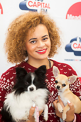 6 November 2013, Meadowhall Sheffield South Yorkshire Fans Watch the Christmas Light Switch On Charity Concert. Little Nikki Back Stage before the Show with her her two pet dogs<br /> <br /> 6th November 2013<br /> Image © Paul David Drabble<br /> www.pauldaviddrabble.co.uk