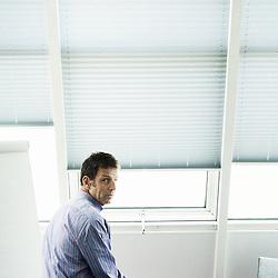 LEVALLOIS-PERRET, FRANCE. AUGUST 29, 2011. Geoffroy Roux de Bezieux, Virgin Mobile's CEO in his office. Photo: Antoine Doyen