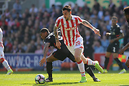 Stoke city's Geoff Cameron and Liverpool's Geroginio Wijnaldum in action. Premier league match, Stoke City v Liverpool at the Bet365 Stadium in Stoke on Trent, Staffs on Saturday 8th April 2017.<br /> pic by Bradley Collyer, Andrew Orchard sports photography.