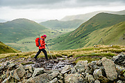 Fells seen on England Coast to Coast hike between Ullswater & Kidsty Pike in Lake District National Park, United Kingdom, Europe. On England Coast to Coast hike with Wilderness Travel, day 6 of 14, from Ullswater to Kirkby Stephen, we hiked 10 miles with 2600 feet cumulative gain in the fells of Lakeland over the highest Roman road in England, then down to the lakeshore of Haweswater. Overnight in Brownber Hall Country House near Kirkby Stephen, in Cumbria county. [This image, commissioned by Wilderness Travel, is not available to any other agency providing group travel in the UK, but may otherwise be licensable from Tom Dempsey – please inquire at PhotoSeek.com.]
