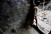SHENGZHOU, CHINA -  china out - finland out<br /> <br /> He Zili is tethered by an iron chain at Gulai Town  in Shengzhou, Zhejiang province of China. He Zili, 11, has suffered from psychosis for ten years. He fell out of bed when he was one year old. He began to attack villagers and damage property belonging to other people at the age of five. At first, his father He Chuyu tethered him to house with ropes, but he often bitted the rope off and ran away. He Chuyu had to tethered his son with a 2m long iron chain. He Chuyu and his son\'s pictures were posted on the Internet several days ago, a netizen saw that He Chuyu led his son with the iron chain and begged for money at a coach station, and took some photos.<br /> ©Exclusivepix