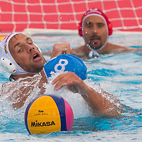 Tamas Kasas (L) of Hungary fights against Valentino Gallo  (front C) of Italy during the Vodafone Waterpolo Cup in Budapest, Hungary on July 16, 2012. ATTILA VOLGYI