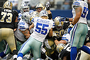 The New Orleans Saints and Dallas Cowboys collide at the line of scrimmage at Cowboys Stadium in Arlington, Texas, on December 23, 2012.  (Stan Olszewski/The Dallas Morning News)