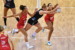 Silver Ferns' Sam Sinclair and England Roses' Geva Mentor compete for possession during the Vitality Netball International Series match at the Echo Arena, Liverpool.