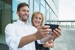 two colleagues with smartphone