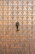 Copper door detail with bronze fish handle at Terra Valentine Winery, Spring Mountain wine growing district near St. Helena in California's famous Napa Valley.