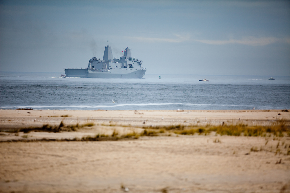 The USS New York built with steal salvaged from the World Trade Center Towers sails out to sea from the Sandy Hook Channel leaving the Navel Weapons Station Earle pier after being stuck in port due to a fierce   nor'easter storm that affected the area .  Here the USS New York passes the tip of Sandy Hook heading to sea.
