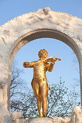 Statue golden playing violin Johann Strauss Vienna