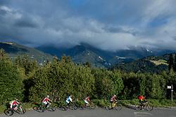 10-09-2017 FRA: BvdGF Tour du Mont Blanc day 2, St. Gervais<br /> Omgeven door imposante bergtoppen en vergezichten rijden we over mooie paden en trails naar de plaats St. Gervais waar we overnachten / Natuur, uitzicht, landschap, Stuwmeer, wegen, groep geel yellow
