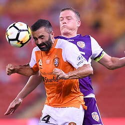 BRISBANE, AUSTRALIA - DECEMBER 21: Fahid Ben Khalfallah of the Roar heads the ball under pressure from Shane Lowry of the Glory during the Round 12 Hyundai A-League match between Brisbane Roar and Perth Glory on December 21, 2017 in Brisbane, Australia. (Photo by Patrick Kearney / Brisbane Roar FC)