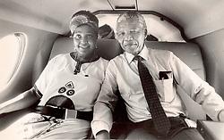 Nelson Mandela & Winnie Mandela together in the back of the car in 1990.