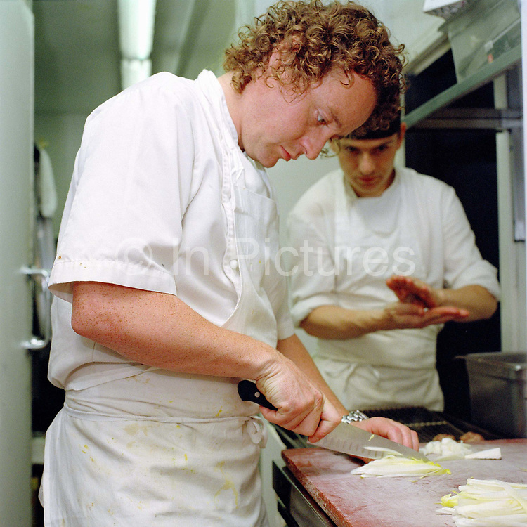 Chef Tom Kitchin working in the kitchen of The Kitchin restaurant, Leith, Edinburgh, Scotland. Tom and Michaela Kitchin opened their restaurant, The Kitchin on Edinburgh's Leith waterfront in 2006. The Kitchin presents modern British seasonal cuisine influenced by French cooking techniques and an appreciation of the best quality ingredients available from Scotland's natural larder.