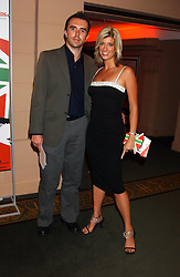 MR ANDY HIPKISS and presenter CAROLINE FARADAY at a party to celebrate 'Made in Italy at Harrods' - a celebration of Italian fashion food and wine, design and interiors, art and photography, cinema and music, beauty and glamour.  The party was held in the Georgian Restaurant at Harrods, Knightsbridge, London on 9th September 2004.<br /><br />PICTURES LICENCED UNTIL 9/3/2004 FOR USE TO PROMOTE THE 'MADE IN ITALY' EVENT/S ONLY.