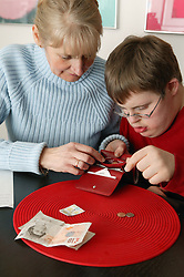 Single parent counting out money with her son,