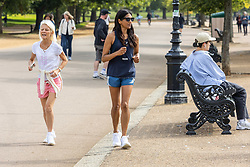 Licensed to London News Pictures. 03/09/202. London, UK. Walkers in Hyde Park, London enjoy a bit of late summer sun with mild temperatures expected today with highs of 23c. Weather forecaster have predicted a mini heatwave from Sunday for England and the South East, with temperatures hitting over 28c on Monday. Photo credit: Alex Lentati/LNP