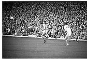 The All Ireland Senior Football Final.1982.19.09.1982.09.19.1982.19th September 1982..The senior final was contested between Offaly and Kerry. Offaly won the title by the narrowest of margins 1.15 to 17 points..a Kerry forward plays the ball forward despite the attentions of the Offaly defender.