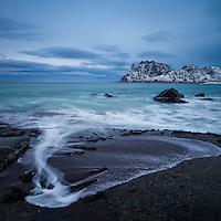 Waves wash over coastal rocks at Uttakleiv beach, Vestvågøy, Lofoten Islands, Norway