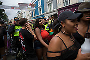 Police presence on Sunday 28th August 2016 at the 50th Notting Hill Carnival in West London. A celebration of West Indian / Caribbean culture and Europes largest street party, festival and parade. Revellers come in their hundreds of thousands to have fun, dance, drink and let go in the brilliant atmosphere. It is led by members of the West Indian / Caribbean community, particularly the Trinidadian and Tobagonian British population, many of whom have lived in the area since the 1950s. The carnival has attracted up to 2 million people in the past and centres around a parade of floats, dancers and sound systems.