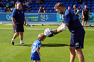 Mascot and AFC Wimbledon goalkeeping coach Ashley Bayes during the EFL Sky Bet League 1 match between AFC Wimbledon and Shrewsbury Town at the Cherry Red Records Stadium, Kingston, England on 14 September 2019.