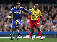 Photo: Lee Earle.<br /> Chelsea v Watford. The Barclays Premiership. 11/11/2006. Chelsea's Didier Drogba battles with Jordan Stewart.