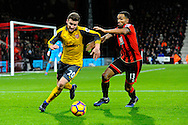 Shkodran Mustafi (20) of Arsenal battles for possession with AFC Bournemouth forward Callum Wilson during the Premier League match between Bournemouth and Arsenal at the Vitality Stadium, Bournemouth, England on 3 January 2017. Photo by Graham Hunt.