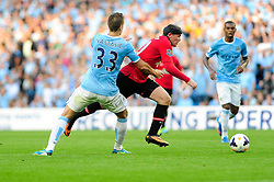 Manchester United's Wayne Rooney passes Manchester City's Matija Nastasic - Photo mandatory by-line: Dougie Allward/JMP - Tel: Mobile: 07966 386802 22/09/2013 - SPORT - FOOTBALL - City of Manchester Stadium - Manchester - Manchester City V Manchester United - Barclays Premier League