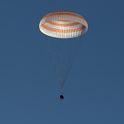 October 4, 2018 - Zhezkazgan, Karagandy Region, Kazakhstan - The Russian Soyuz MS-08 spacecraft drifts back to Earth carrying the International Space Station Expedition 56 crew October 4, 2018 near Zhezkazgan, Kazakhstan. American astronauts Drew Feustel and Ricky Arnold of NASA, along with Russian Soyuz Commander Oleg Artemyev are returning after 197 days in space. (Credit Image: © Bill Ingalls via ZUMA Wire)