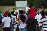 Gary Stancie carries his grandson, Kaine Brown, 6, during a protest at Craig Ranch North in response to an incident with teens and police officers at a community pool in McKinney, Texas on June 8, 2015.  (Cooper Neill for The New York Times)